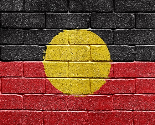 bigstock_Flag_Of_Aborigines_On_Brick_Wa_5249790